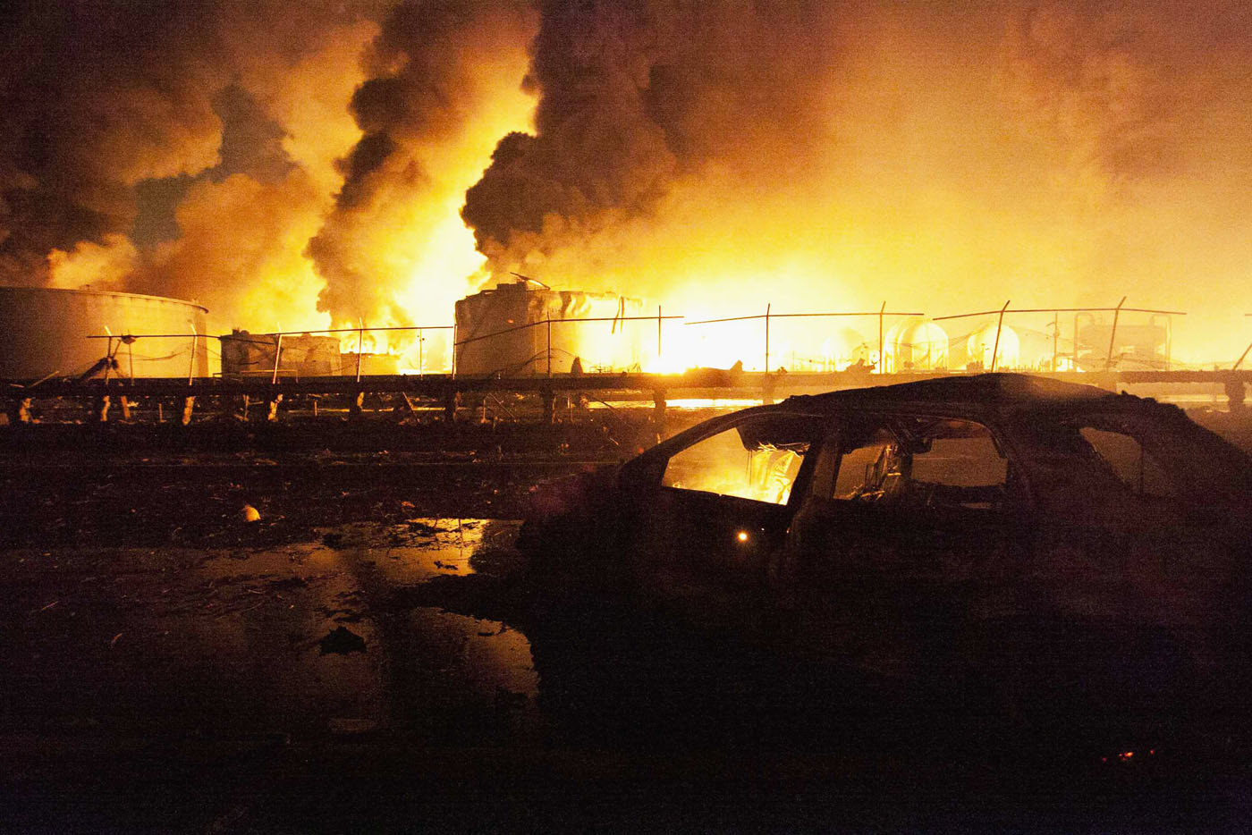 A burnt car is see in the affected area after an explosion at Amuay oil refinery in Punto Fijo